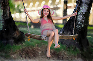 Young woman on swing.