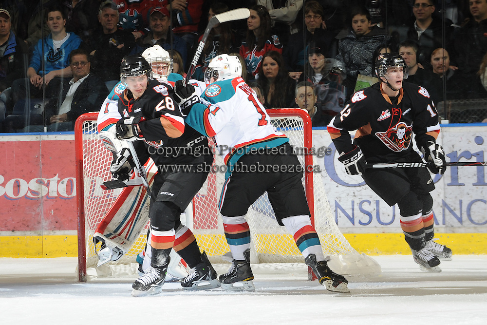 KELOWNA, CANADA, FEBRUARY 17:  Collin Bowman #28 of the Calgary Hitmen is checked by Carter Rigby #11 of the Kelowna Rockets at the Kelowna Rockets on February 17, 2012 at Prospera Place in Kelowna, British Columbia, Canada (Photo by Marissa Baecker/Shoot the Breeze) *** Local Caption ***