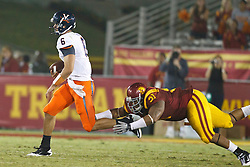 September 11, 2010; Los Angeles, CA, USA;  Virginia Cavaliers quarterback Marc Verica (6) is tackled by Southern California Trojans defensive tackle Jurrell Casey (91) during the fourth quarter at the Los Angeles Memorial Coliseum. USC defeated Virginia 17-14.
