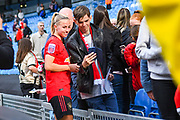 Manchester United Women midfielder Jackie Groenen (14) takes a selfie with a fan during the FA Women's Super League match between Manchester City Women and Manchester United Women at the Sport City Academy Stadium, Manchester, United Kingdom on 7 September 2019.