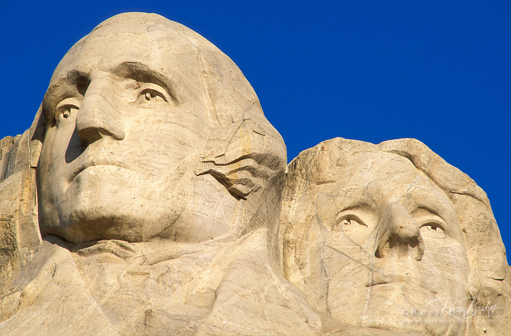 Morning light on Washington and Jefferson detail, Mount Rushmore National Memorial, South Dakota USA