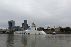 © Licensed to London News Pictures. 10/09/2016. LONDON, UK.  Motor Yacht A leaves London passing 'The Walkie-Talkie', 'Cheesgrater' and 'Gherkin' skyscrapers and Tower of London before going under Tower Bridge on the River Thames early this morning. The £225m superyacht, owned by Russian billionaire, Andrey Melnichenko (known as the King of Bling) has spent the last week moored next to HMS Belfast during a London visit. Motor Yacht A is 390ft long, was designed by Philippe Starck, inspired by a submarine and is now reported to be up for sale because Melnichenko is building a new superyacht.  Photo credit: Vickie Flores/LNP