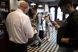 © Licensed to London News Pictures . 25/07/2015 . Manchester , UK . Caffe Nero . Visitors to Comic Con on the streets of Manchester after venue - Manchester Central's - doors are shut . Photo credit : Joel Goodman/LNP