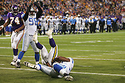 MINNEAPOLIS - NOVEMBER 21:  Running back Onterrio Smith #32 of the Minnesota Vikings gets tackled in the end zone for a safety by defensive end Cory Redding #78 of the Detroit Lions at the Hubert H. Humphrey Metrodome on November 21, 2004 in Minneapolis, Minnesota. The Vikings defeated the Lions 22-19. ©Paul Anthony Spinelli  *** Local Caption *** Onterrio Smith;Cory Redding