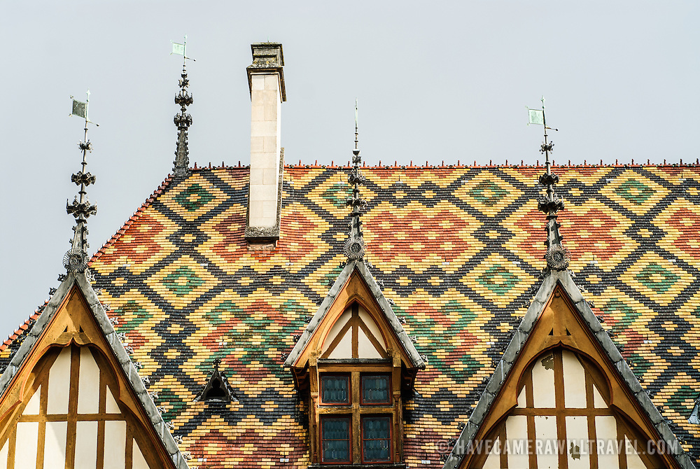 The colorful tiled roof of the Hotel Dieu / Hospices de Beune in Beaune in the heart of France's Burgundy (Bourgogne) region. The historical Hotel Dieu was once a hospital.