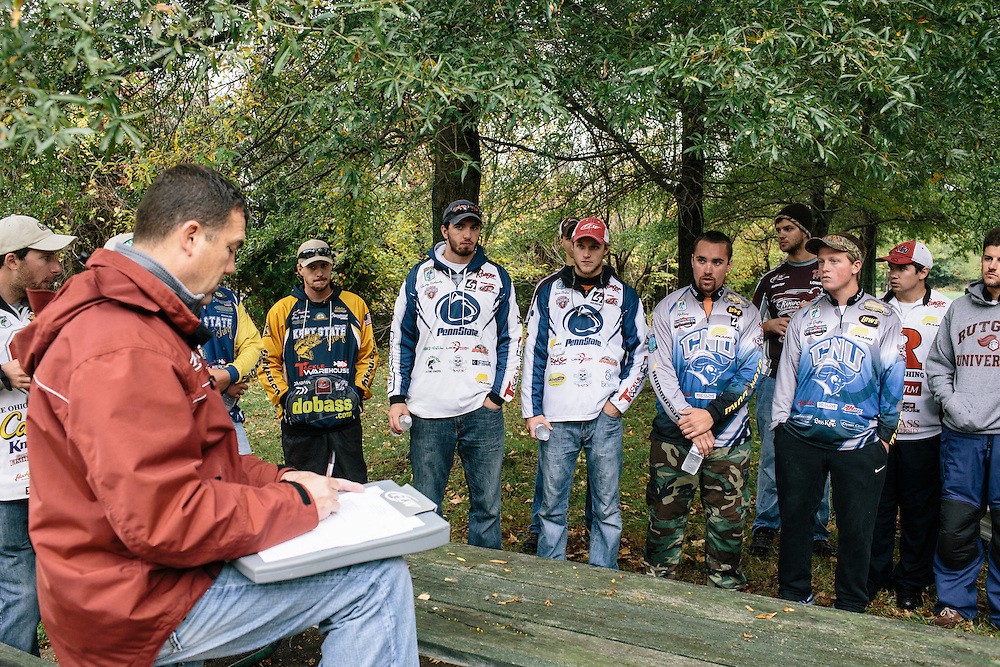 Competitors who advanced to Sunday in the fishing tournament gather for a team meeting with tournament director Kevin Hunt, left, during the FLW College Fishing Northern Conference Invitational in Marbury, MD on Oct. 11, 2014. Teams that went on stage showing specific sponsor logos were paid additional prize money.