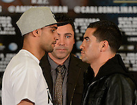 Dec 12,2012. Los Angeles CA. USA.. Amir Khan(L), Oscar De La Hoya(C.) faces off with Carlos Molina(R.) during a Los Angeles press conference. The fight will be scene on ShowTime live from the Los Angeles Sports Arena. Photo by Gene Blevins/LA Daily News