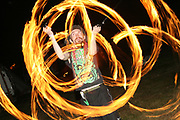 A performer swinging fire Poi Poi at the Workhouse Festival, Wales, 2006