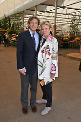 NIGEL HAVERS and his wife GEORGIANA BRONFMAN at the 2011 RHS Chelsea Flower Show VIP & Press Day at the Royal Hospital Chelsea, London, on 23rd May 2011.