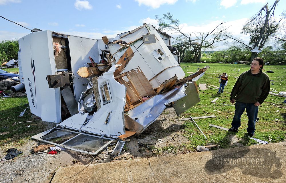 Daily Photo by Gary Cosby Jr.  ..Residents in Swan Creek, a mobile home community on Highway 31 near Tanner, Ala., recover belongings Thursday, April 28, 2011 left from Wednesday's destructive tornado.  Brandon Boyce looks at the remains of his parents' mobile home.