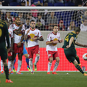 Will Johnson, Portland Timbers, shoots past the New York Red Bulls wall during the New York Red Bulls Vs Portland Timbers, Major League Soccer regular season match at Red Bull Arena, Harrison, New Jersey. USA. 24th May 2014. Photo Tim Clayton