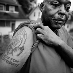 """""""Praying time for everybody"""" shouts the tattoo of Robert Harvey who had just finished a 40 oz malt liquor at 6:38 in the morning. """"It's in memory of my brother who was shot dead by the police. God rest his soul."""""""