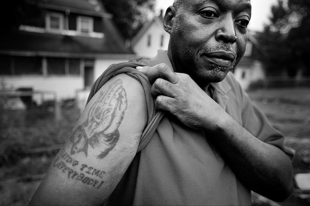 """Praying time for everybody"" shouts the tattoo of Robert Harvey who had just finished a 40 oz malt liquor at 6:38 in the morning. ""It's in memory of my brother who was shot dead by the police. God rest his soul."""