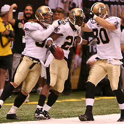 Oct. 8, 2006; New Orleans, LA, USA; New Orleans Saints running back (25) Reggie Bush celebrates with teammates after a 65-yard punt return against the Tampa Bay Buccaneers during the fourth quarter at the Louisiana Superdome in New Orleans, LA. Mandatory Credit: Derick E. Hingle