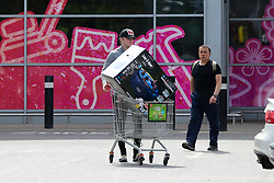 © Licensed to London News Pictures. 27/04/2020. London, UK. A shopper with paddling pool leaves Homebase in Haringey, north London which opened today. The lockdown continues to slow the spread of COVID-19 and reduce pressure on the NHS. Photo credit: Dinendra Haria/LNP