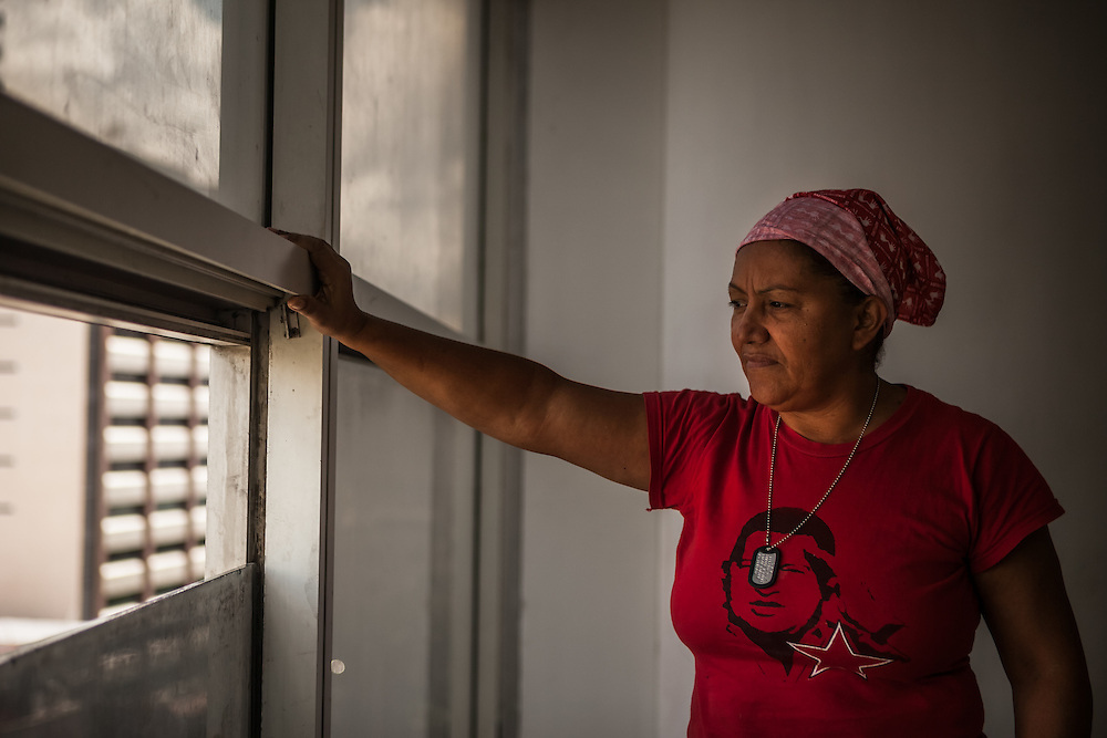 María Eugenia Guerrero, 51, is Chavista, a socialist government supporter. She moved to the tower in 2007 after her home in a slum was destroyed in a gas explosion.  She was one of the original invaders that took over the tower, she said out of necessity because she had lost everything.  She invented a pully system to bring water up to her family from the ground floor. PHOTO: Miguel Gutierrez
