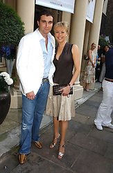 LADY ALEXANDRA SPENCER-CHURCHILL and DAVID PEACOCK at the annual Michele Watches Summer Party held in the gardens of Home House, 20 Portman Square, London W1 on 15th June 2006.<br />
