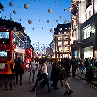 People stroll on a Saturday afternoon in Oxford Circus in London on November 2, 2013. The intersection between Oxford Street and Regent's Street is the main shopping center within Inner London.