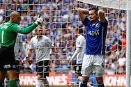 Sam Hird of Chesterfield holds his head in his hands after missing a good opportunity to equalise during the Johnstone's Paint Trophy Final match at Wembley Stadium, London<br /> Picture by David Horn/Focus Images Ltd +44 7545 970036<br /> 30/03/2014