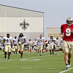 July 28, 2012; Metairie, LA, USA; New Orleans Saints quarterback Drew Brees (9) with teammates during a training camp practice at the team's practice facility. Mandatory Credit: Derick E. Hingle-US PRESSWIRE