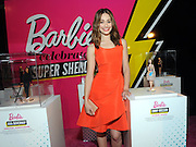 "Emmy Rossum poses with her one-of-a-kind Barbie at the Variety Power of Women event, Friday, April 24, 2015, in New York, where she was honored as a Barbie ""Shero.""  Emmy, along with Ava DuVernay, Eva Chen, Kristin Chenoweth, Sydney ""Mayhem"" Keiser and Trisha Yearwood, are the first ever Barbie Sheroes, which celebrates women who are inspiring girls.  (Photo by Diane Bondareff/Invision for Barbie/AP Images)"