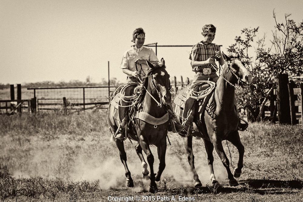 Colby and Brady McDonald riding Tigger and the bay mare at Warren Ranch at Katy Prairie Conservancy; Katy; Texas