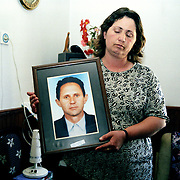 Ageja Sokoli. Widow of war. Her four sons are still missing and husband were taken away by the serbian police in a night raid.  She has never seen them since. Their bodies have never been found. She is holding a picture of her husband.