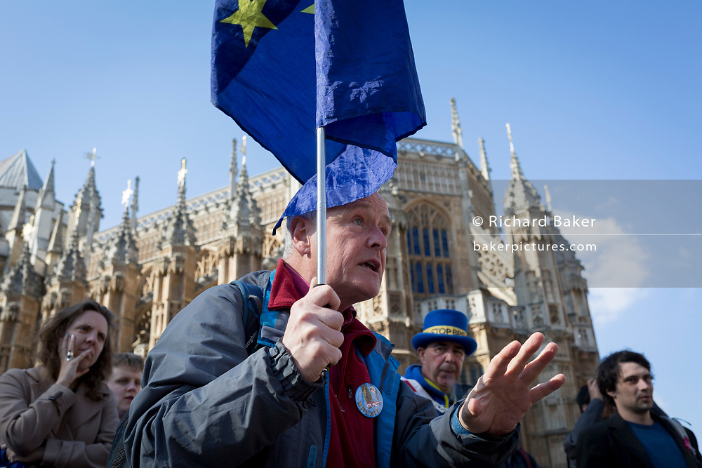 On the day that Prime Minister Theresa May returns to Brussels to negotiate an expected Brexit delay, a pro-EU remainer argues outside parliament in Westminster, in London, England.
