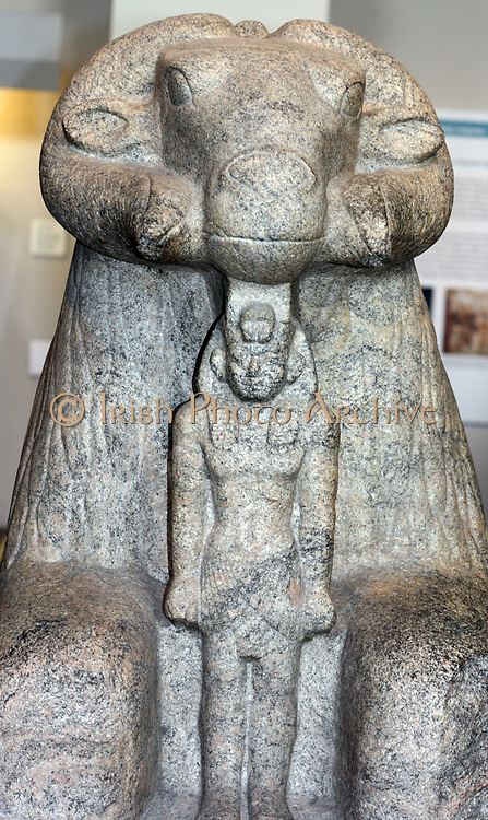 Granite Statue of Amun Ram protecting King Taharqa. 25th Dynasty (Approx. 690-664 BC) Egyptian, from Kawa in Nubia. Found by Professor Francis Llewellyn Griffith in 1930-1 in the Temple of Amun.