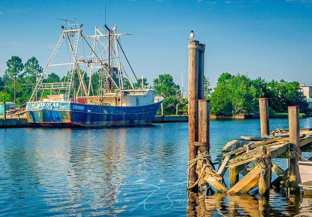 "A rusty shrimp boat, ""Nikolas,"" is docked in Bayou La Batre, Alabama, May 9, 2015. (Photo by Carmen K. Sisson/Cloudybright)"