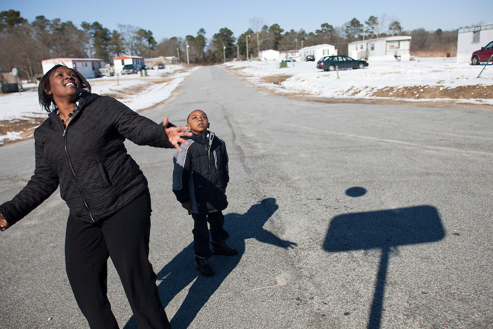 Justin Cobb and his mother, Latonia Best, play basketball outside their home near La Grange, N.C., on Sunday, Feb. 14, 2010. Justin recently had a bad earache and recovered without the aid of antibiotics, as advised by a doctor. ..D.L. Anderson for The Wall Street Journal.EAR