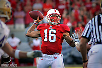 Wolfpack quarterback Russell Wilson makes a throw against Western Carolina. PHOTO BY ROGER WINSTEAD