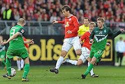 05.02.2011, Bruchwegstadion, Mainz, GER, 1. FBL, FSV Mainz 05 vs Werder Bremen, im Bild Petri Pasanen (Bremen #3), Andreas IVANSCHITZ (Mainz AUT #25), Aaron Hunt (Bremen #14), EXPA Pictures © 2011, PhotoCredit: EXPA/ nph/  Roth       ****** out of GER / SWE / CRO  / BEL ******