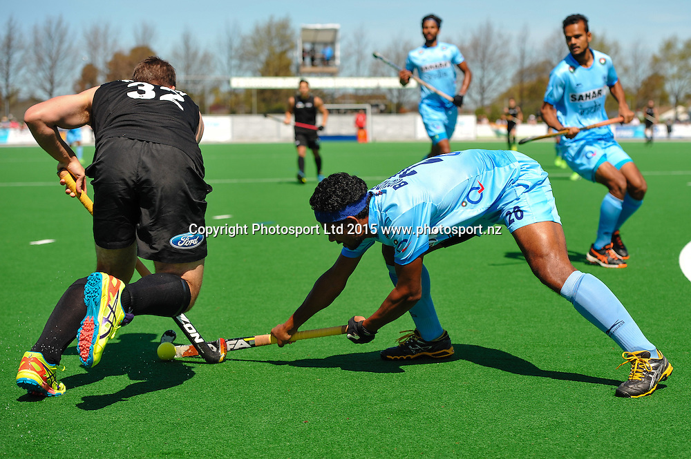 Nick WILSON of the Black Sticks is tackled by Birendra Lakra of India during the Mens Hockey International, 2015 South Island Tour game between the New Zealand Black Sticks V India, at Marist Park, Christchurch, on the 11th October 2015. Copyright Photo: John Davidson / www.photosport.nz