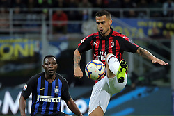 October 21, 2018 - Milan, Milan, Italy - Suso #8 of AC Milan competes for the ball with Kwadwo Asamoah #18 of FC Internazionale Milano during the serie A match between FC Internazionale and AC Milan at Stadio Giuseppe Meazza on October 21, 2018 in Milan, Italy. (Credit Image: © Giuseppe Cottini/NurPhoto via ZUMA Press)