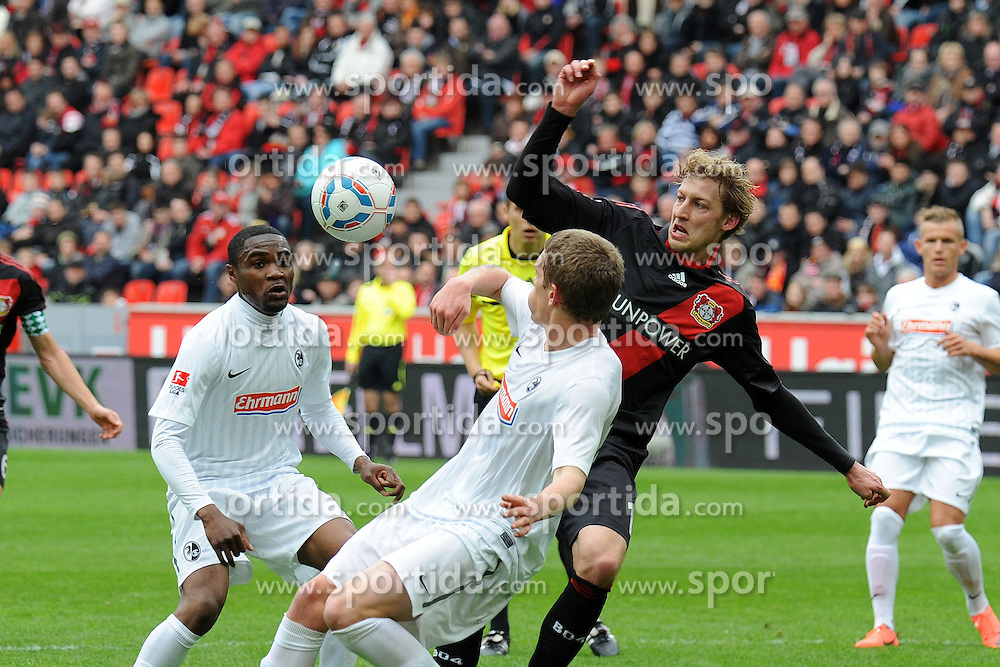 31.03.2012, Bayarena, Leverkusen, GER, 1. FBL, Bayer 04 Leverkusen vs SC Freiburg, 28. Spieltag, im Bild Stefan Kiessling ( rechts Bayer 04 Leverkusen ) im Zweikampf mit Cedrick Makiadi ( links ) und Matthias Ginter ( mitte beide SC Freiburg/ Action/ Aktion ) // during the German Bundesliga Match, 28th Round between Bayer 04 Leverkusen and SC Freiburg at the Bayarena, Leverkusen, Germany on 2012/03/31. EXPA Pictures © 2012, PhotoCredit: EXPA/ Eibner/ Thomas Thienel..***** ATTENTION - OUT OF GER *****
