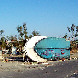 Scenes of devastation left in the aftermath of Hurricane Katrina that flooded the small city of Buras, Louisiana in Plaquemines Parish on August 29, 2005. A boat marked by the owner sits off the roadway in Empire, Louisiana...(Mandatory Credit: Photo by Derick E. Hingle)