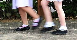 """File photo date 15/07/14 of a generic stock photo of school girls walking to school. Some pupils """"have not eaten for two days"""", teachers report, as child poverty concerns continue to rise."""