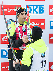 Second placed FOURCADE Martin (FRA) and fourth placed BEATRIX Jean Guillaume (FRA) at medal ceremony after the Men 15 km Mass Start at day 4 of IBU Biathlon World Cup 2014/2015 Pokljuka, on December 21, 2014 in Rudno polje, Pokljuka, Slovenia. Photo by Vid Ponikvar / Sportida