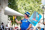 Steve Bray, Anti-Brexit activist demonstrates outside the Cabinet Office in Whitehall, London, Great Britain <br /> 21st August 2019 <br /> <br /> Steve Bray AKA Mr Stop Brexit with his trademark placards and megaphone outside the Cabinet Office.<br />  <br /> Photograph by Elliott Franks