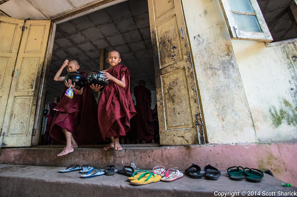 Two novice monks leave the meal hall in Yangon, Myanmar