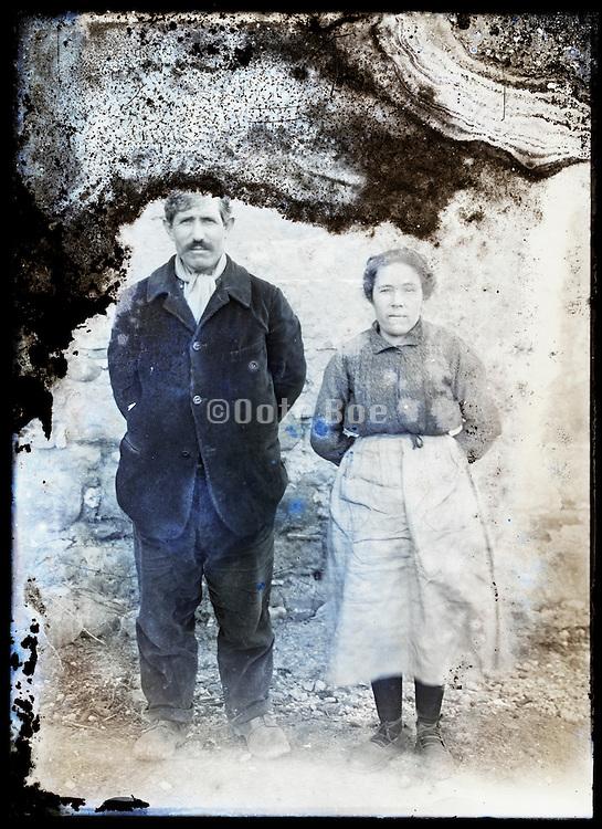 eroding glass plate photo of farmers couple