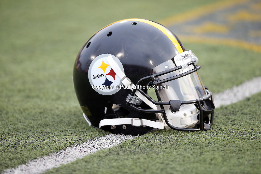 A Pittsburgh Steelers lies on the turf before the 2015 NFL Pro Football Hall of Fame preseason football game against the Minnesota Vikings on Sunday, Aug. 9, 2015 in Canton, Ohio. The Vikings won the game 14-3. (©Paul Anthony Spinelli)