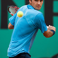 08 June 2007: Swiss player Roger Federer hits a backhand shot to Russian player Nikolay Davydenko during the French Tennis Open semi final won 7-5, 7-6(5), 7-6(7), by Roger Federer over Nikolay Davydenko on day 13 at Roland Garros, in Paris, France.