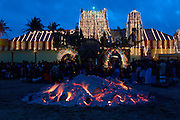 Udappu fire walking festival. The Hindu Temple as a backdrop. the tamamrind tree logs abalze.