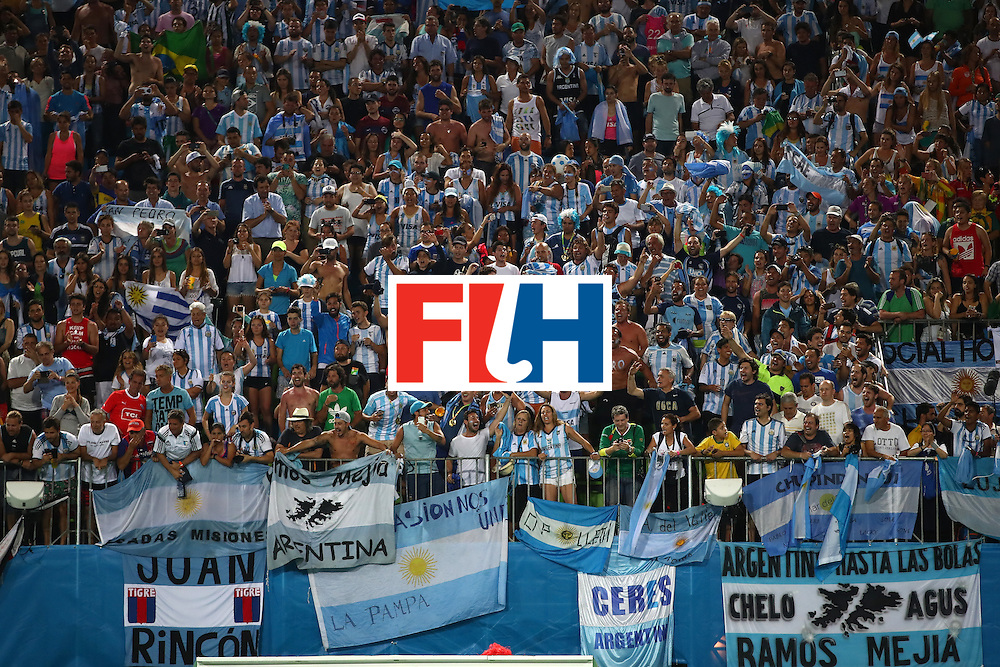 RIO DE JANEIRO, BRAZIL - AUGUST 18:  Argentinian fans celebrate their teams victory in the Men's Hockey Gold Medal match between Belgium and Argentina on Day 13 of the Rio 2016 Olympic Games at Olympic Hockey Centre on August 18, 2016 in Rio de Janeiro, Brazil.  (Photo by Clive Brunskill/Getty Images)