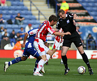 Photo: Mark Stephenson.<br /> Leicester City v Stoke City. Coca Cola Championship. 29/09/2007.The Referee holds the ball up from Stokes Richard Cresswell and Leicester's Mark De Vries