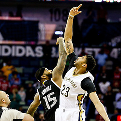 Mar 7, 2016; New Orleans, LA, USA; New Orleans Pelicans forward Anthony Davis (23) and Sacramento Kings center DeMarcus Cousins (15) jump at the opening tip off during the first quarter of a game at the Smoothie King Center. Mandatory Credit: Derick E. Hingle-USA TODAY Sports