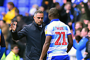 Reading manager Jose Gomes celebrates the 2-1 win with Yakou Meite (21) of Reading at full time during the EFL Sky Bet Championship match between Reading and Brentford at the Madejski Stadium, Reading, England on 13 April 2019.