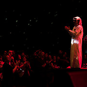 """October 3, 2015 - New York, NY : The performance artist Laurie Anderson collaborated with former Guantánamo detainee, Mohammed el Gharani, in the production of """"Habeas Corpus,"""" an art installation featuring a larger-than-life projection of el Gharani displayed in the Park Avenue Armory drill hall. Here, the Syrian musician Omar Souleyman, right, performs on stage in """"Out of Body,"""" a performance component of the exhibit held in the drill hall on Friday night. CREDIT: Karsten Moran for The New York Times"""